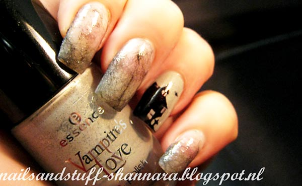 beige spider web haunted house halloween nails