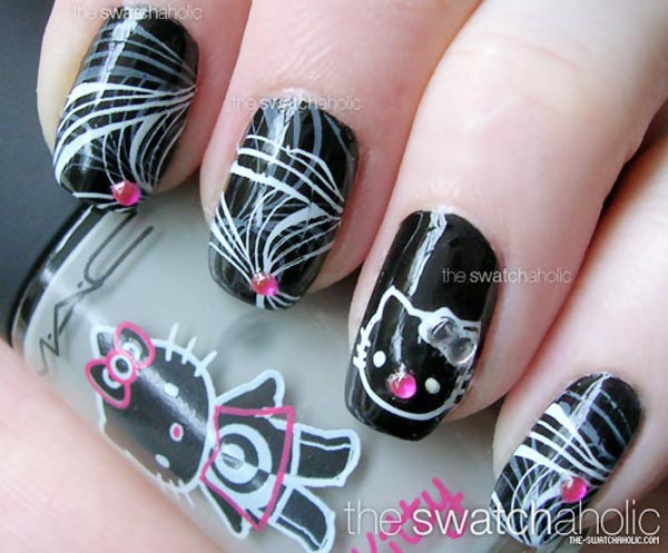 black and white marbled hello kitty nails