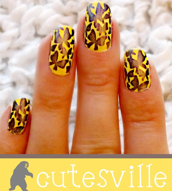 black butterflies stamped on yellow nails