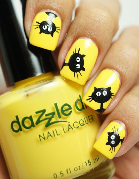 black cats on yellow nails