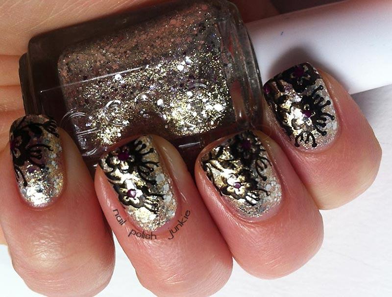 black flowers gold glitter nails
