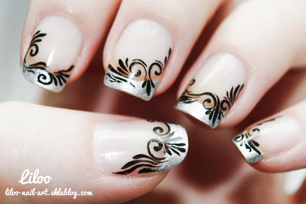 black freehand arabesque over silver french nails