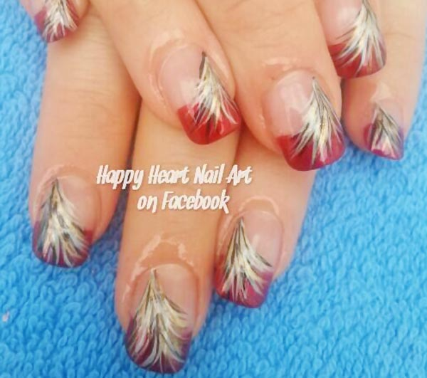black gold feathers red french nails