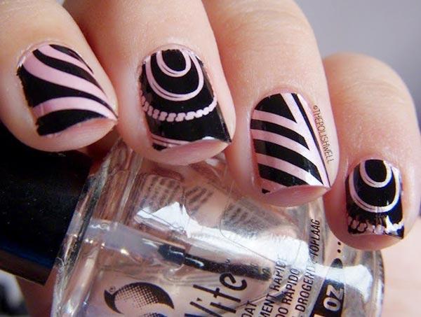 black patterns over pink nails