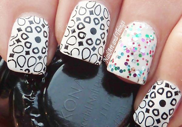 black stamped glitter accent white nails