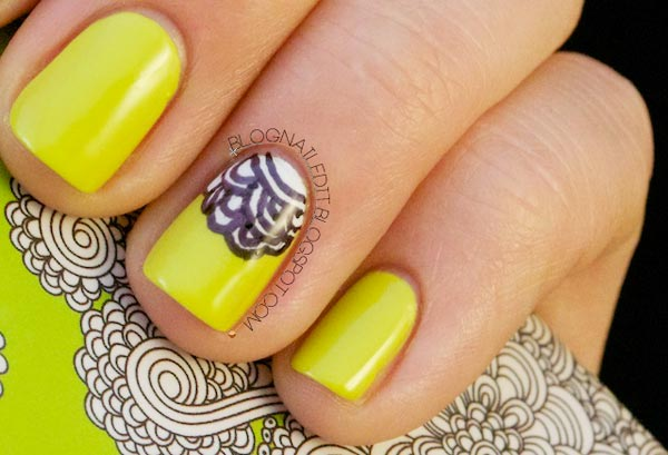 black white flowers on yellow nails