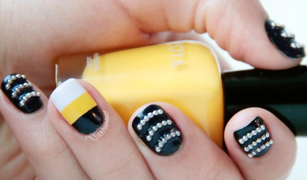 black white yellow studded waves nails