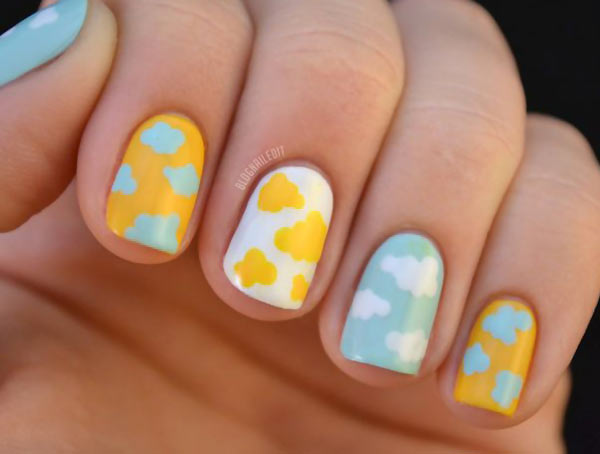 blue yellow white pastel clouds nails
