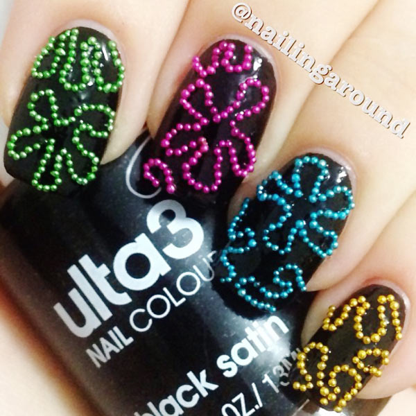 colorful beads flowers accented black nails