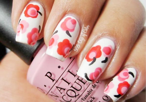 coral dotted flowers white spring nails