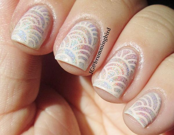 cream stamp over holographic nails