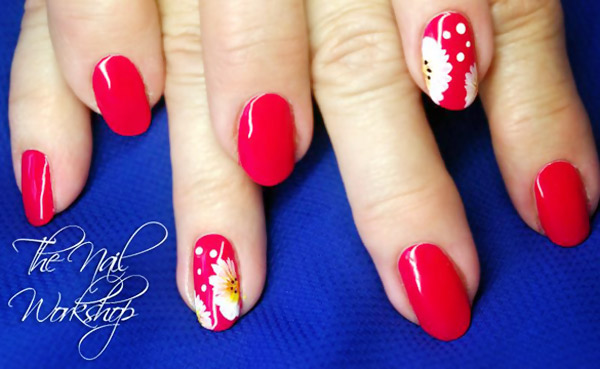 daisy accents on red spring nails
