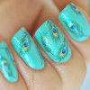 feathered aqua nails