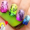 flowers feathers stamped rainbow gradient nails