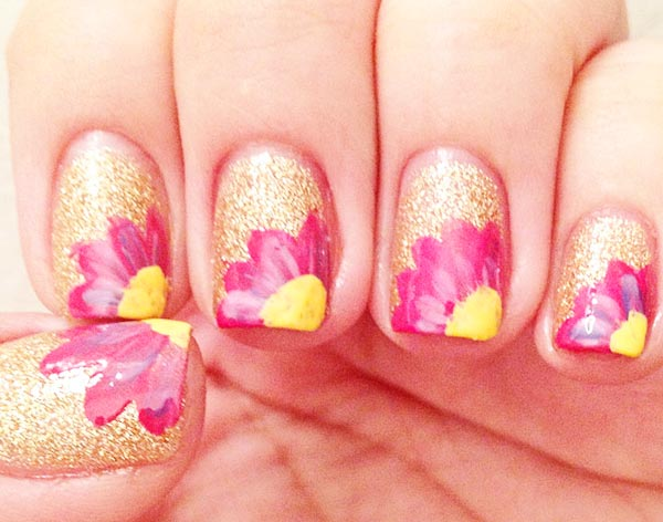 flowers on golden glitter nails