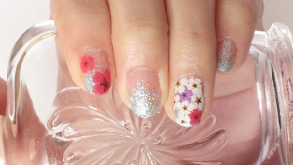flowers on silver glitter gradient nails