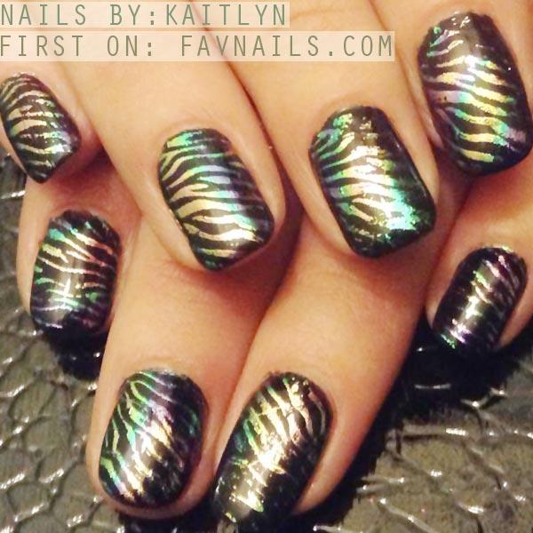 foil stamped zebras on black nails
