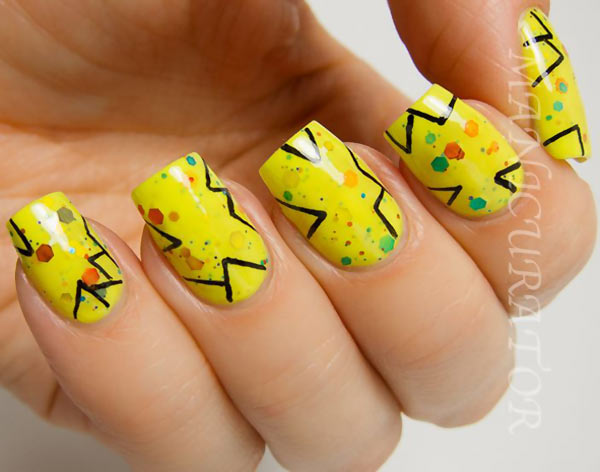 freehand black lines over yellow confetti nails