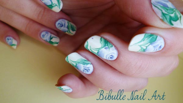 freehand blue roses on white nails