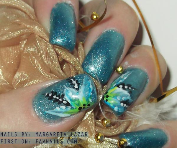 freehand flowers on blue shimmer nails
