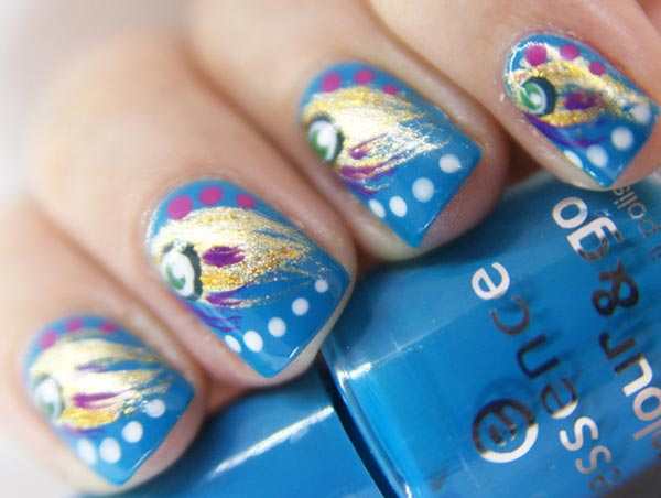 freehand peacock dotted blue nails