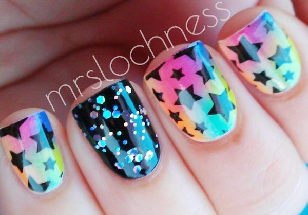glitter stamped stars on neon gradient nails