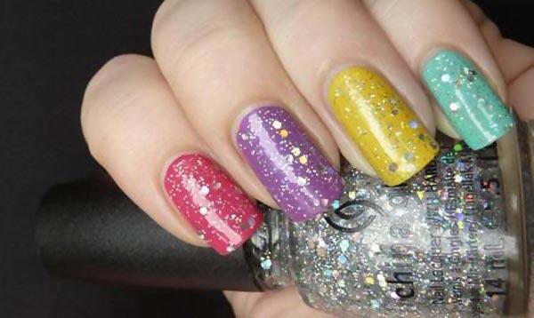 glitter topcoat over rainbow nails