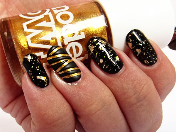 gold glitter black striped accent gold nails