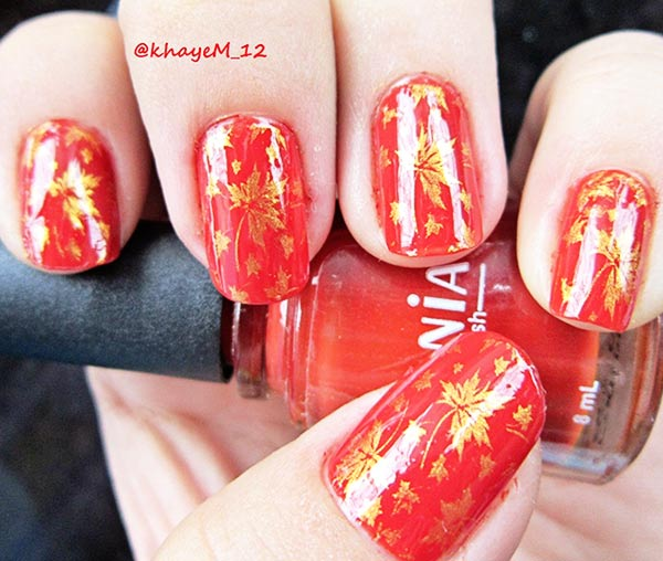 gold leaves stamped on orange fall nails
