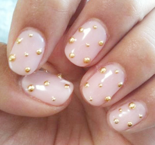 gold studded light pink nails