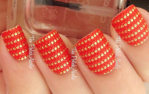 golden applique rows on orange nails
