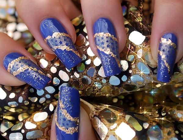 golden decoration on blue nails