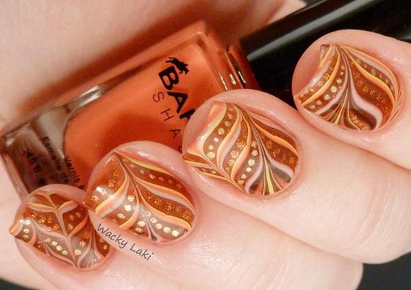 golden dots marbled fall nails