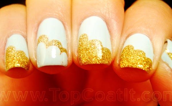 golden shimmer clouds light blue nails