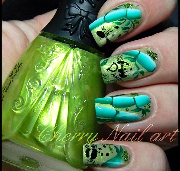gorgeous green bamboo panda nails