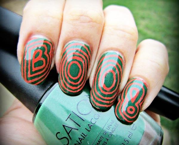 halloween orange on green nails