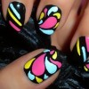 neon drops graphic black nails