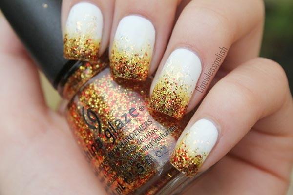 orange glitter dipped white nails