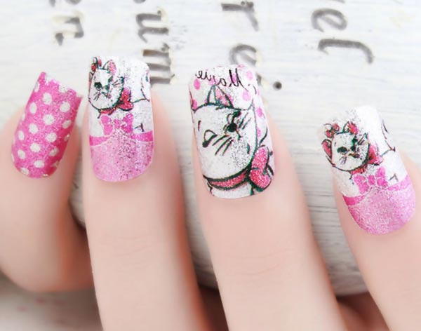 pink dotted aristocats nails