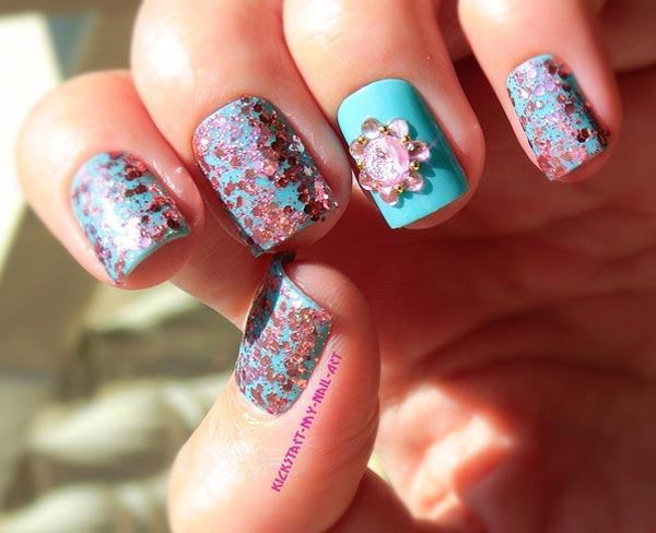 pink glitter flower on turquoise nails