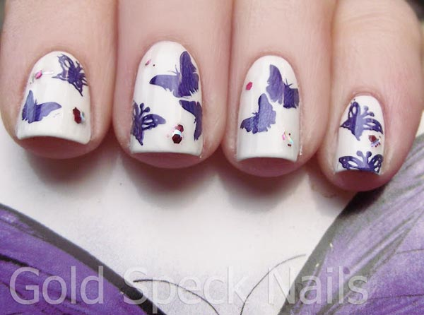 sequins purple butterfly stamped on white nails