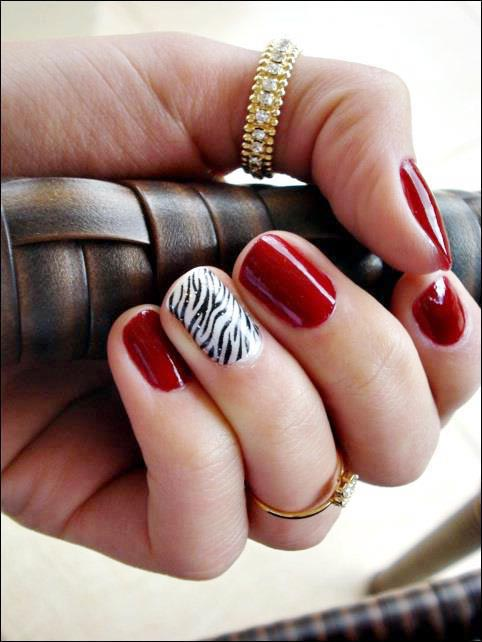 red and zebra nails