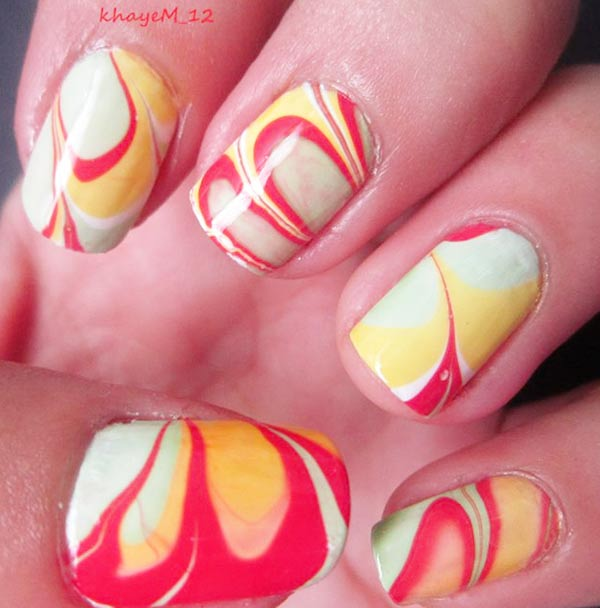 red blue yellow pastel marbled nails