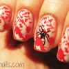 stamped red splatter spider halloween nails