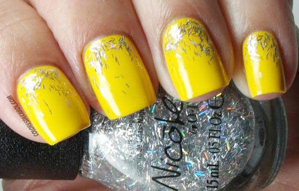 silver flakes on yellow nails