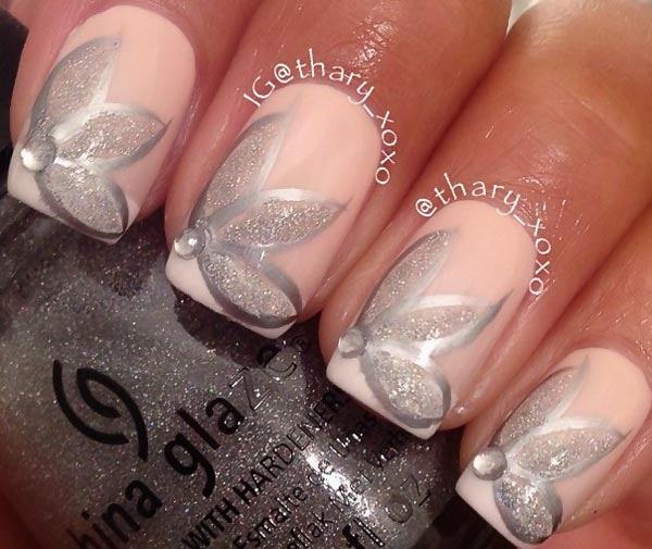 silver glitter flowers on soft pink nails