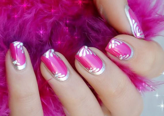 silver motifs on fuchsia nails