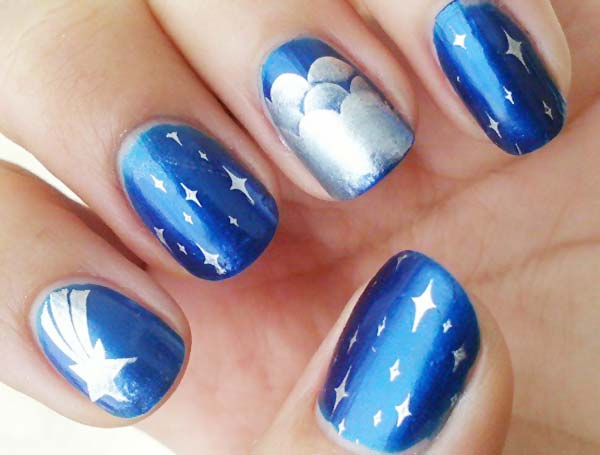 silver stamped blue starry night nails