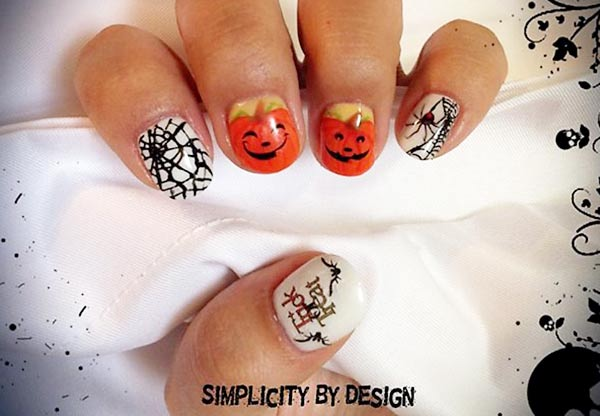 spiderweb happy jackolanterns halloween nails