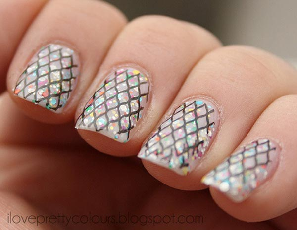 stamped fishnet over glitter nails